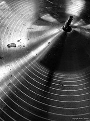 Crashing (Little Hand Images) Tags: crashcymbal drumset component drumhardware blackandwhite shiny brass round grooves dirty unclean monochrome