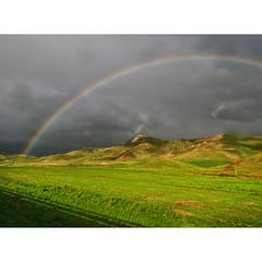 Rainbow (Robyn Hooz) Tags: arcobaleno temporale nuvole clouds erba green grass smile sorriso sicilia sicily