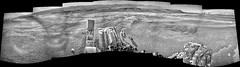 Mountains of Gale Crater, variant (sjrankin) Tags: 14june2019 edited nasa mars msl curiosity galecrater panorama rocks sand dust grayscale navcam mountains craterrim mountsharp sky haze craterfloor tracks wheeltracks shadow