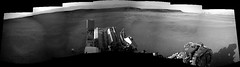Mountains of Gale Crater (sjrankin) Tags: 14june2019 edited nasa mars msl curiosity galecrater panorama rocks sand dust grayscale navcam mountains craterrim mountsharp sky haze craterfloor tracks wheeltracks shadow