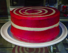 The Cat in the Hat's Bithday Cake (Steve Taylor (Photography)) Tags: cake swirl design shop bakery red white plate cans uk gb england greatbritain unitedkingdom london