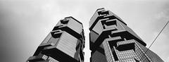 reflection (stevenwonggggg) Tags: hasselblad xpan analog film city kodak trix400 bw blackandwhite architecture