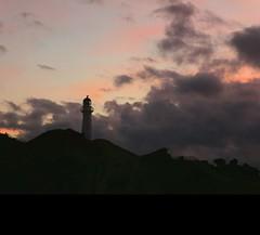 Castlepoint sunrise (Julie McLennan) Tags: castlepoint lighthouse sunrise clouds pink grey newzealand northisland coast