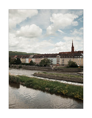 Anonymous' City (Thomas Listl) Tags: thomaslistl color würzburg 35mm 35mm14 city town cityscape river water rivermain waterscape buildings sky clouds blue grass green av af ngc