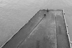 There will be better days / walking in the rain (Özgür Gürgey) Tags: 2019 20mm bw cesarepavese d750 elbe elbphilharmonie hafencity hamburg nikon voigtländer alone diagonal leading lines people pier umbrella