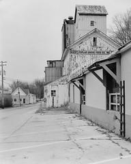 Poplar Grove Feed Co. (Christopher J May) Tags: 8x10 bw bnw blackandwhite feedmill grainelevator il ilfordhp5 illinois kodak12 f63 commercial ektarkorona 8x10monochromepoplar grove film
