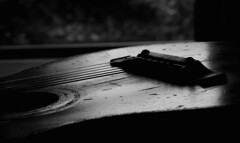 old guitar by morning light (HansHolt) Tags: old morning bw music monochrome backlight daylight guitar acoustic strings tegenlicht gitaar snaren sixstring canonef100mmf28macrousm canoneos6d musicinbw smileonsaturday lowkey