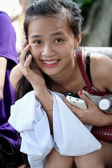 """A Vietnamese """"phone"""" girl,  Sa Pa, Vietnam. She was using 3 phones to make a phone calls (adamba100) Tags: asia asian china chinese korea korean mongolia mongolian vietnam vietnamese thai beijing town city view landscape cityscape street life lifestyle style people human person man men woman women male female girl boy child children kid interesting portrait innocent cute charm pretty beauty beautiful innocence play face headshot pure purity tourism sightseeing tourist travel trip light color colour outdoor traditional cambodia cambodian phnom penh sony a6300 18105 siem reap pattaya bangkok field gate architecture tree building"""