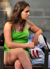 Satisfied with her purchases (chrisk8800) Tags: girl youngwoman shoppingbags shorts candid street barcelona