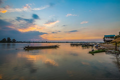 First Impact (Andrea Gambadoro) Tags: blue reflection boat laos south asia sky clouds morning early sunrise sea mekong river water peace quiet silence landscape seascape photography photographer