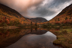 Sunrise at Crawford Notch (Walter Levin) Tags: newhampshire whitemountains crawfordnotch fall autumn sunrise morning mountains lake clouds reflections sunlight trees colorful