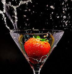 Strawberry (Bernie Condon) Tags: red black water glass fruit studio strawberry flash wave splash