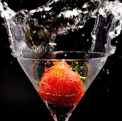 Strawberry (Bernie Condon) Tags: glass strawberry fruit water splash wave red black flash studio