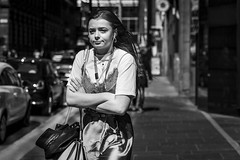 Home Time (Leanne Boulton) Tags: urban street candid portrait portraiture streetphotography candidstreetphotography candidportrait streetportrait eyecontact candideyecontact streetlife woman female girl face eyes expression emotion mood feeling enigmatic smile work lanyard earbuds style fashion tone texture detail depthoffield bokeh naturallight outdoor light shade city scene human life living humanity society culture lifestyle people canon canon5dmkiii 70mm ef2470mmf28liiusm black white blackwhite bw mono blackandwhite monochrome glasgow scotland uk
