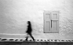 (cherco) Tags: woman greece mykonos solitario solitary silhouette alone architecture aloner lonely light luz window ventana silueta shadow street solo loner arquitectura monochrome movement movimiento composition canon composicion city ciudad blackandwhite blancoynegro speed