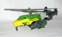 springer transformers idw thrilling 30 voyager class triple changer last stand of the wreckers hasbro 2013 x (tjparkside) Tags: springer transformer transformers generations idw thrilling 30 autobot autobots wrecker wreckers movie triple changer g1 generation 1 one sword rotor gun rifle blaster cannon projectile projectiles firing launching missile missiles shooting helicoper vehicle armored car truck hasbro 2014 2012 voyager class green yellow last stand 2013
