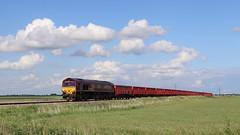 Under Simpsons clouds. (Duck 1966) Tags: class66 ews dbs diesel locomotive stone train turves fenland sky clouds