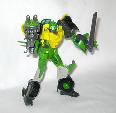 springer transformers idw thrilling 30 voyager class triple changer last stand of the wreckers hasbro 2013 n (tjparkside) Tags: springer transformer transformers generations idw thrilling 30 autobot autobots wrecker wreckers movie triple changer g1 generation 1 one sword rotor gun rifle blaster cannon projectile projectiles firing launching missile missiles shooting helicoper vehicle armored car truck hasbro 2014 2012 voyager class green yellow last stand 2013