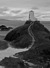 Twr Mawr Lighthouse (JinxiPhotography) Tags: monochrome black white bw lighthouse dramatic sea cliff view path wales anglesey uk twr mawr beach rock waves trees hill mountain water