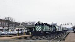 BN 8063, 8112 (EMD SD40-2's)  @ Western Springs IL (hardhatMAK) Tags: bn8063 bn8112 emssd402 eastbound freighttrain westernspringsil 12201986 scannedslide kodachrome64