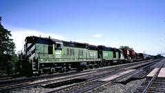 BN 6204, 2359 (EMD SD9, GP38-2) @ Galesburg IL (hardhatMAK) Tags: bn6214 bn2359 emdsd9 emdgp382 freighttrain westbound galesburgil 691985 burlingtonnorthern scannedslide kodachrome64