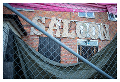 Waiting for new management (leo.roos) Tags: saloon decay verval fence hek oskarshamn harbour haven ferry gotland lens heliosautowideangle128f28mm m42 a7 helios2828 madeinjapan swedengotlandspring2019 zweden darosa leoroos bar cafe pub