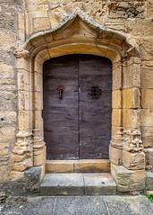 Old doorway (Donard850) Tags: france sarlatlacaneda door doorway old weathered weatheredwood stonework fuji xt20