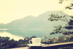 White cup of hot coffee on nature background. Bali island. Volcano Batur. (Artem Beliaikin) Tags: coffee cup espresso drink breakfast food cafe background white closeup beverage table hot caffeine morning cappuccino natural green aroma mug brown fresh space black bean wood wooden old vintage break nature decoration art style steam plant agriculture design plantation landscape retro roasted mocha shop mountain seed texture field smoke farm