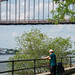 Candid Man Under Hell's Gate Bridge from Astoria Park, NYC