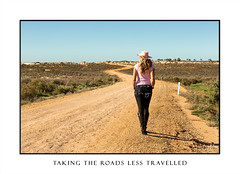 Woman walks a winding dirt road in outback Australia (sugarbellaleah) Tags: woman remote australia desert outback arid dry drought climate walking female people hat pink dirtroad travel tourism vacation holiday fashion jeans boots mungo lunette nationalpark unplugged person alone copyspace realpeople genuine countryside centralausralia saltbush lakemungo wavy winding