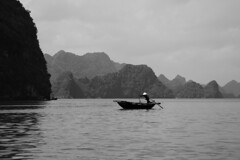 Fishing boat in Halong Bay (Vietnam) (www.holgersbilderwelt.de) Tags: vietnam halongbay boat nature beautiful white light sky water black travel people landscape beach art woman forest mountain ocean natural reflection island pretty outdoor monochrome way fine botany classic kunst weather scenic silhouette lovely tranquility season countryside traditional asia perspective waterscape schwarzweiss nationalpark aperture