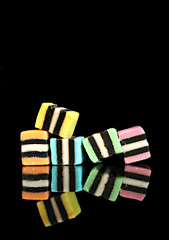 2019 Sydney: Licorice Allsorts (dominotic) Tags: 2019 food confectionery lolly reflection blackbackground licoriceallsorts yᑌᗰᗰy foodphotography sydney australia