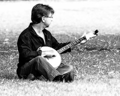 Plucking in the Park (Mel Low) Tags: smileonsaturday musicinblackandwhite mono candid