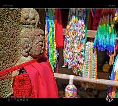 Colours of Worship (tomraven) Tags: buddha temple tomraveninjapan japan aravenimage tomraven stone cloth offerings colour worship buddhism japanese q22019 lumix lx100