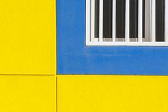 Blue window, yellow wall (Jan van der Wolf) Tags: map194358vv window raam wall muur facade gevel gebouw geometric geometry bars tralie lanzarote arrecife lines lijnen