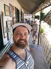 Stellenbosch   Oom Samie Se Winkel (Toni Kaarttinen) Tags: southafrica africa cape capetown travel travelling holiday wanderlust westerncape wine winelands stellenbosch oomsamiesewinkel oom samie se winkel shop vintage man beard guy bear cub shoulders tattoo adidas
