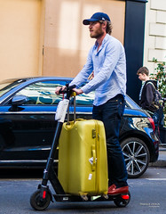 Street - Kick scooter traveller (François Escriva) Tags: street streetphotography paris france people candid olympus omd photo rue colors sidewalk man kick scooter suitcase yellow golden gold cap blue shirt car building