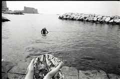 (Summer of 2019) (Robbie McIntosh) Tags: leicamp leica mp rangefinder streetphotography 35mm film pellicola analog analogue negative leicam analogico blackandwhite bw biancoenero bn monochrome argentique dyi selfdeveloped filmisnotdead autaut candid strangers leicaelmarit28mmf28iii elmarit28mmf28iii elmarit 28mm arsimagofd arsimagofddeveloper arsimagofd139 seaside rocks ilfordfp4 ilford fp4 man woman mappatellabeach lidomappatella