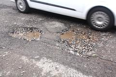 Mind that pothole.!!! (Yesteryear-Automotive) Tags: leekstaffordshire leek staffordshire staffordshiremoorlands potholebritain potholes pothole puddles puddle gardenstreetleekstaffordshire hole holes