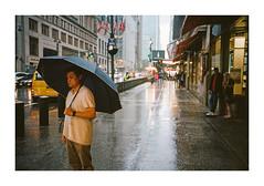 FILM - Outside Grand Central in the rain (fishyfish_arcade) Tags: 35mm analogphotography canonsureshotz135 filmphotography filmisnotdead istillshootfilm kodak newyork portra400 analogcamera compact film streetphotography rain umbrella