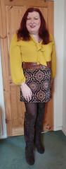 Mustard pussybow blouse multi mini skirt standing (dianne66uk) Tags: boots pussybow blouse mini skirt hoisery makeup wide belt redhair