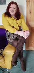 Mustard pussybow blouse multi mini skirt sitting3 (dianne66uk) Tags: boots pussybow blouse mini skirt hoisery makeup wide belt redhair