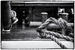 Docked (Art de Lux) Tags: niendorf harbour germany deutschland balticsea ostsee ship schiff passenger passagier rope tau bollard poller doublecrossbollard doppelkreuzpoller bw blackandwhite sw schwarzweis monochrome monochrom mft microfourthirds artdelux legs beine excursionboat ausflugsboot harbor