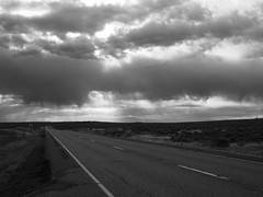 Rain Ahead (Nick Condon) Tags: clouds idaho inl landscape olympus25mm olympusem10 rain road storm sun