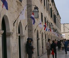 Dubrovnik (dramadiva1) Tags: flags tourists dubrovnik walking pedestrians shutters architecture