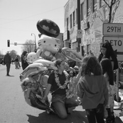 untitled (kaumpphoto) Tags: rolleiflex 120 tlr city urban street ilford bw black white minneapolis balloon exchange mylar hellokitty batman dolphin lei ribbon