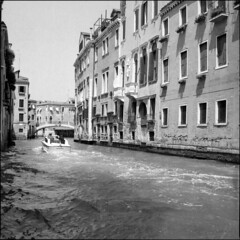 Venezia #9 (BG Sixtyniner) Tags: venice italia venezia canal boat gliding passingby boatride buildings ancient historic city water sea film analog bw blackwhite mediumformat roll 120square 6x6 ilford delta400 perceptol stock paterson homedev hasselblad500cm carlzeiss planar f28 80mm vuescan canoscan9000f