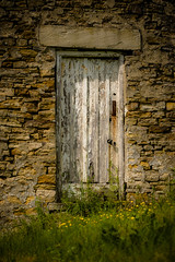 Old barn door (tonguedevil) Tags: outdoor outside countryside spring nature barn door stone building flowers colour light shadows sunlight fuji