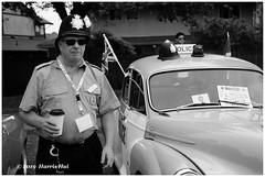 Controversial Police Figure - Steveston Car Show XT7124e (Harris Hui (in search of light)) Tags: harrishui fujixt1 digitalmirrorlesscamera fuji fujifilm vancouver richmond bc canada vancouverdslrshooter mirrorless fujixambassador xt1 fujixcamera fujixseries fujix fujixf35mmf2 fujiprimelens fixedlens standardlens police steveston stevestonclassiccarshow richmondlionsclubsockeyerun controversial hongkongprotest force excessiveforce extraditionbill bw blackwhite monochrome portrait car morrisminor carowner