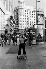 taking a call, madrid (stevebanfield) Tags: streetphotography street city nikonfm2 nikon monochrome spain scan woman shotonfilmstore bw madrid blackandwhite ilford film ilfordphoto